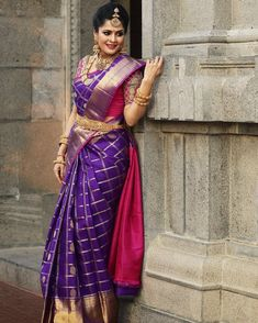 South Indian bride. Gold Indian bridal jewelry.Temple jewelry. Jhumkis. Purple and pink silk kanchipuram sari. Bun with fresh flowers. Tamil bride. Telugu bride. Kannada bride. Hindu bride. Malayalee bride.Kerala bride.South Indian wedding. Pinterest: @deepa8