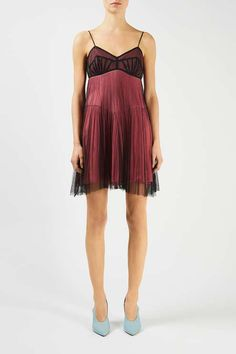The Lincoln Dress rides the line between lingerie and evening wear for a sensuous going-out look. In antique pink silk with a sheer black mesh overlay, this slinky mini dress is fundamental for party season. #Topshop