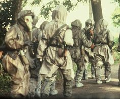East German soldiers on a 20 km march in full protective gear.