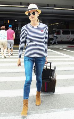 Diane Kruger wears a Comme des Garçons striped top, skinny jeans, suede ankle boots, and a fedora