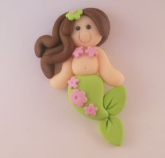 Polymer Clay Bead or Bow Center - Green and Pink Mermaid. $3.25, via Etsy.