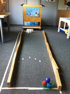 Bowling Alley in a Preschool Classroom. Could use pool noodles with PVC pipe connectors.