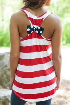 Get ready for July with this cute red, white, and blue tank top! Fourth of July fashion with a cute polka dot bow.