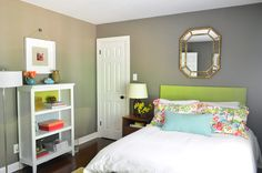 Color accents - paint on the inside of the bookcase. The matching ribbon hanging the picture to coordinate with the mirror above the bed.