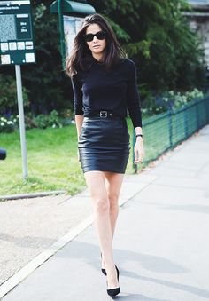 Classic all-black look with a knit and belted leather skirt.