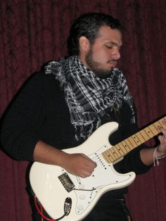 Obed Alexis Santiago, our guitarist