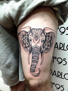 Geometric elephant thigh tattoo