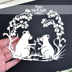 http://paperinkandknife.com/shop/a-flower-for-you-papercut/