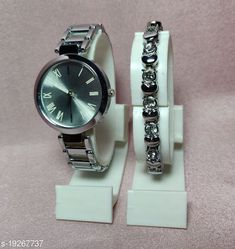 Watches new titan with breaclet watches combo Strap Material: Metal Display Type: Analogue Size: Free Size Multipack: 1 Country of Origin: India Sizes Available: Free Size   Catalog Rating: ★4.1 (5093)  Catalog Name: Stylish Women Watches CatalogID_3962018 C72-SC1087 Code: 552-19267737-297