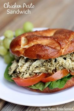 Chicken Pesto Sandwich is a shredded chicken salad mixture with homemade pesto, served with mozzarella, tomato, and spinach on a crispy roll.