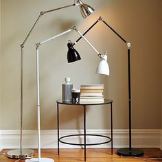 "Industrial Task Floor Lamps #westelm 10""diam. x 68.5""h. Iron tubing and base with polished nickel finish. Adjustable arm locks at two angles. Imported."