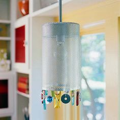 Chic Shade  Inspired by a charm bracelet, this metal shade gives pretty lighting an edge.    Try This Project  -- Bend and glue a sheet of pierced aluminum around a duct cap.  -- Lace the seam with wire.  -- Dangle washers, marbles, and prisms from the wire