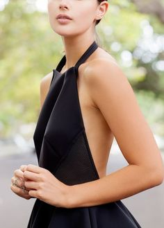 Show off those toned shoulders with a backless halter dress.