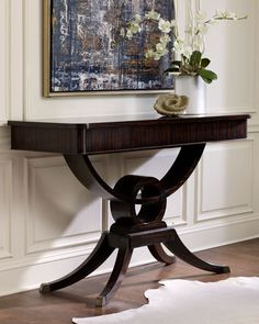 "Handcrafted console. Made of acacia wood. Macassar ebony veneer finish with boxwood inlays and brass-plated feet. Frieze rail conceals three drawers. 57""W x 21""D x 37""T. Boxed weight, approximately 18"