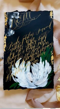 Sumptuously hand painted wedding menu design with acrylic paint, white watercolour edges, gold foil, deckled edges and gold calligraphy. What could be better for a luxury wedding invitation experience? By Crimson Letters. Visit the link below.