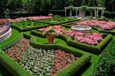 Garden with Boxwood Hedges and Roses by Chalet Nursery and Garden Center, Wilmette, IL