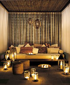 Cabana decor with modern moroccan lanterns and low brass tea tray.