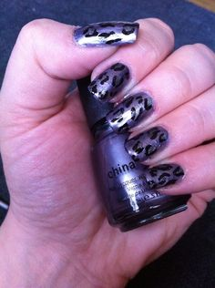 Metallic leopard in varying shades of silver and charcoal