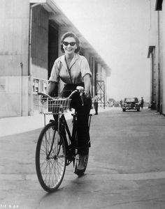 Jean Simmons pedals through the M-G-M lot at the time of Until They Sail 1957