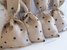 I like the fabric bags with a simple bow tie & some polka dots.