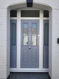 Give your home a gorgeous front with our stylish range of Oak front doors in Essex. With tailor-made installation, we give you exact results you are after. Grey Upvc Doors, Grey Front Doors, Porch Doors, Windows And Doors, Composite Front Doors Uk, End Terrace House, Front Door Makeover, House Extension Design, Home Porch