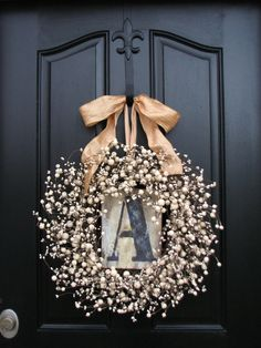 The recycling and repurposing possibilities are endless! 18. Personalized Wreath