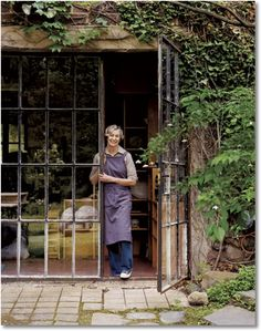 love these doors (and her hand-made dishes).... tore this page out of magazine years ago and stored in my dream book..