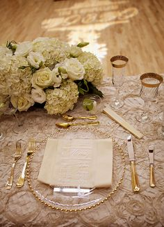 Head Table Place Setting: Antique ivory silk linen (La Tavola Linens), Gold beaded glass charger, Gold flatware, Rimmed glass. Menu printed on thin, transparent acrylic sheet. Glass ball with round place card / by VancityAllie