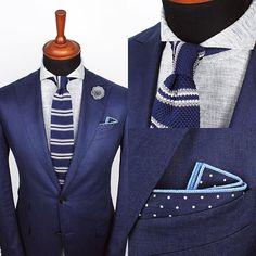 The Indigo stripe knitted tie, Gray lapel pin and Navy blue dot pocket square. www.Grandfrank.com