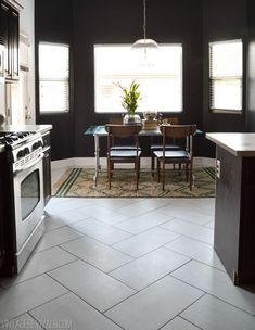 Modern Kitchen Flooring Tile Pattern Ideas pictures, photos, material, on a budget, vinyl, inexpensive, farmhouse, laminate, victorian, with dark cabinets, cheap, wood, oak, cork, stone, transition, linoleum #kitchenfloor