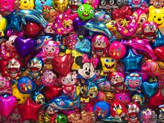 """Says Bolin of his decision to conceal himself in the background of his images: """"The real world seems more like an imprisonment of the creativity of the human race."""" Hiding in the City -- Balloon, by Liu Bolin, 2012. Photograph courtesy Klein Sun Gallery, New York."""