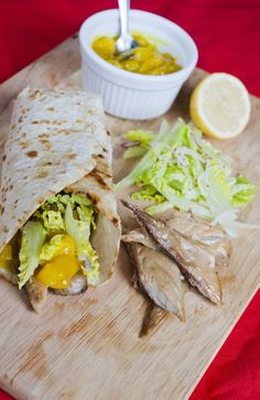 Mackerel and Piccalilli Wrap - A super quick, but super satisfying snack or starter, with sharp piccalilli complementing the mackerel perfectly - http://www.fishisthedish.co.uk/recipes/fast-fish/1415-mackerel-and-piccalilli-wrap