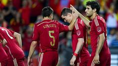 Fernando Torres (C) of Spain celebrates with his teammates Cesar Azpilicueta (L) and Javi Martinez of Spain