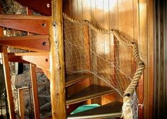 Nautical rope and fish net for spiral staircase railing http://www.oregonbeachvacations.com/