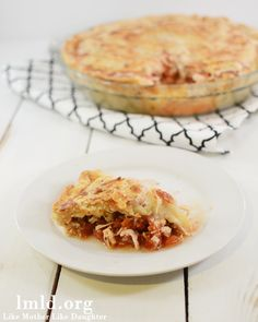 This Chicken Parmesan Pot Pie is a combo of italian flavors and delicious pot pie. The chicken and tomato flavors go so well with the flaky buttery pie crust!