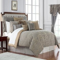 A sophisticated jacquard damask scroll design created with polyester and chenille in shades of beautiful champagne and grey. A champagne small-scaled medallion pattern on the reverse. Chenille gold/grey cord finish. Set includes two coordinating standard shams and a box pleated bed skirt. Features - 100% Polyester with exclusive of decoration - Dry clean only - Hidden zipper on sham - Reversible Comforter - Dust Ruffle/Bed Skirt Included: Yes - Cleaning Method: Dry clean only Product Details…