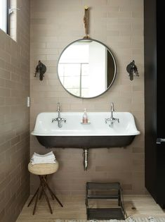 C Magazine - bathrooms - taupe tile, taupe bathroom tile, taupe tiled walls, round captains mirror, rope hung vanity mirror, captains vanity...