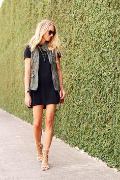 black dress, olive vest, nude sandals, gold necklace