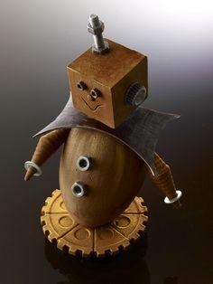Robochoc de Christophe Michalak Un oeuf avec une tête au carré et des oreilles en boulons, un sourire et un ventre plein de bonbons pralinés