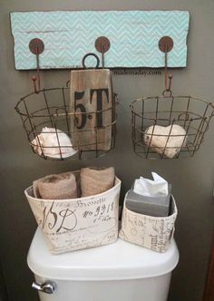 hang baskets on wall hook... perfect for storing garden gloves, trowels, etc.