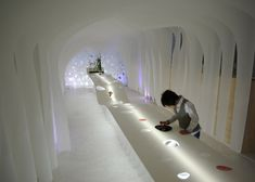 Kotaro Horiuchi creates a Paper Cave inside his architecture studio.