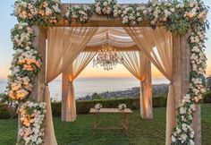 The ceremony design was strategically placed with the Pacific Ocean as the backdrop! Soft peach chiffon reclaimed wood structure and an elegant chandelier provided the foundation for the beautiful florals. Wedding Mandap, Wedding Ceremony, Wedding Venues, Perfect Wedding, Dream Wedding, Sunset Wedding, Wedding Beauty, Wedding Arch Rustic, Chuppah