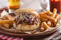 Tender pulled pork is topped with slaw and served in a bun - the ultimate lunchtime sandwich! Discover more pulled pork recipes at Tesco Real Food.