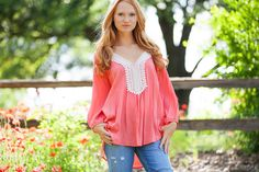This cute Gauzy beach top screams summer and beach days!  Perfect worn as a tunic with shorts, or looks fabulous as a suit cover up!  Features an open crochet lace on deep V-neckline with gathered 3/4 sleeves.   High-low design. Unlined and Lightweight.