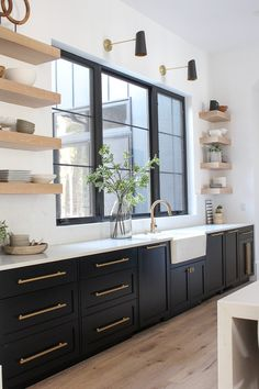 Modern Kitchen Interior Remodeling floating white oak shelves with black cabinets kitchen - Kitchen design tips on creating a contemporary design kitchen that is practical and beautiful. Featuring rift sawn white oak cabinetry and floating shelves. Black Kitchen Cabinets, Black Kitchens, Home Kitchens, Black Kitchen Decor, Kitchen With Gold Hardware, White Countertop Kitchen, Modern Kitchens, Kitchen Modern, Distressed Kitchen