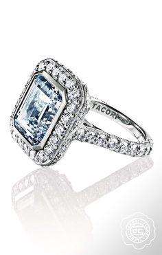 There's something undeniable about an emerald cut diamond in a bezel setting.  TACORI engagement ring #Starlit collection