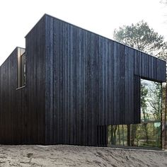 The blackened-timber facades of this house in a coastal nature reserve near The Hague are interrupted by carefully positioned openings that frame views of the surrounding forest. Architecture Panel, Residential Architecture, Modern Architecture, Architecture Portfolio, Modern Scandinavian Interior, Scandinavian Architecture, Facade Design, Exterior Design, Wood Facade