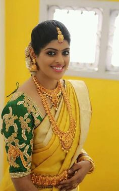 Lovely Yellow with Green Stone and embroidery work blouse Netted Blouse Designs, Bridal Blouse Designs, Blouse Neck Designs, Kerala Bride, South Indian Bride, Indian Bridal, Blouse Designs Catalogue, Back Neck Designs, Designer Blouse Patterns