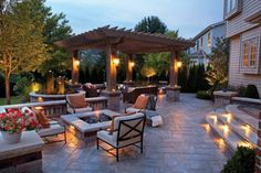 Patio by Unilock with fireplace and Rivenstone paver
