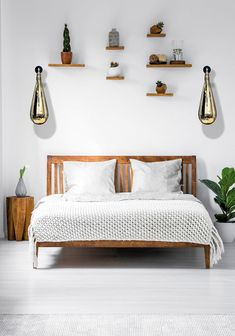 Wooden framed double bed with two pillows and a blanket, and small shelves above in a white bedroom interior. Contemporary Wall Lights, Discount Bedroom Furniture, Bedroom Arrangement, Kitchens And Bedrooms, Relax, Decoration Design, Bright, Malaga, Living Room Lighting